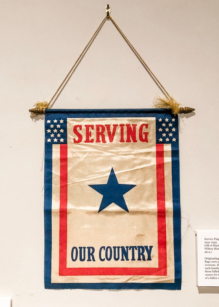A Service Flag from World War 2, from the Wilton Historical Society. (Gift of Marilyn Gould, Permanent Collection).