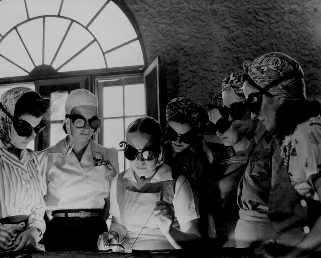 """Secretaries, housewives, waitresses, women from all over central Florida are getting into vocational schools to learn war work. Typical are these in the Daytona Beach branch of the Volusia county vocational school."""" Howard R. Hollem, April 1942. 208-AA-352V-4. National Archives Identifier: 535579"""