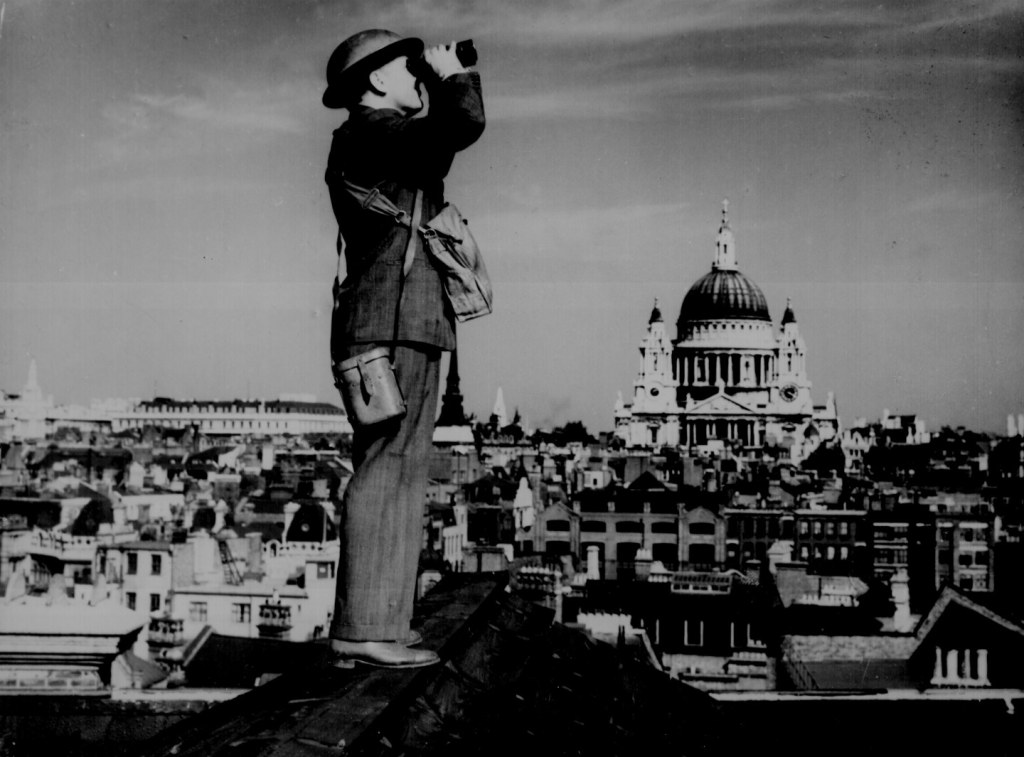 Aircraft spotter on the roof of a building in London