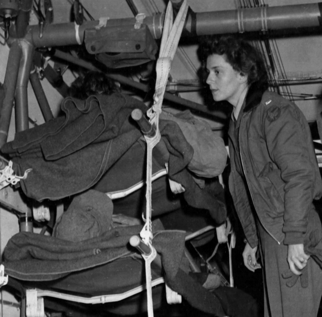 Army flight nurse Lt. Suella Bernard tends to patients in one of two CG-4A gliders waiting for C-47 transport to tow them to a military hospital in France. Bernard became the only nurse known to have participated in a glider combat mission during World War II. For this mission, she received the Air Medal.