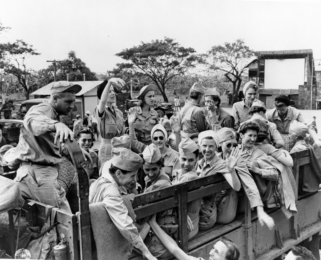 U.S. Army Nurses from Bataan and Corregidor leaving Manila in trucks after being freed from three years imprisonment at the Santo Tomas Internment Compound in the Philippines. The nurses are wearing new uniforms given to them to replace their worn out clothes. 12 February 1945.