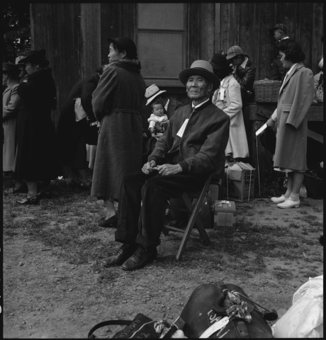 Centerville, California. A grandfather awaits evacuation bus. Evacuees of Japanese ancestry will be housed in War Relocation Authority centers for the duration.